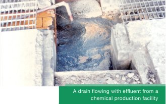 A drain flowing with effluent from a chemical production facility