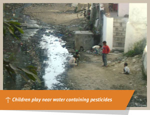 Children play near water containing pesticides