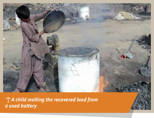 a child melting recovered lead from a used battery